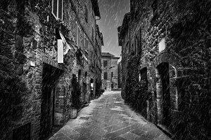 Dark narrow street in black & white.