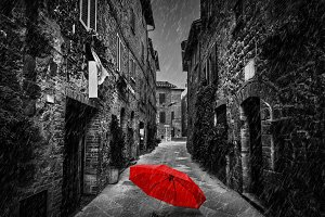 Red umbrella in the narrow street.