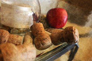 Corks and Apple on Table