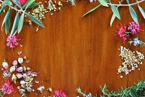 Wood background with herbs, flowers