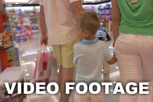Family walking in toy shop