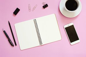 Creative workspace desk on pink