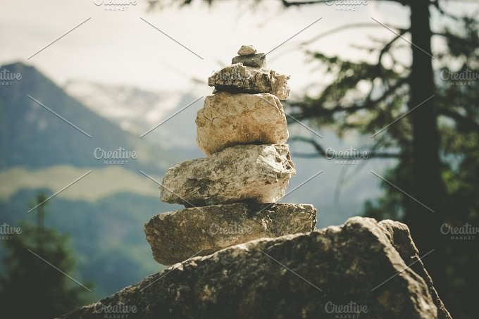 Stacked rocks / Cairn. Alps. - Nature