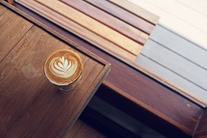 latte on wooden desk