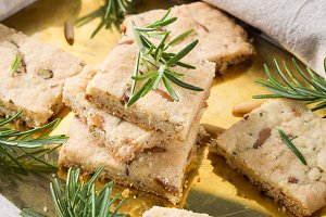 Cookies with rosemary on golden tray