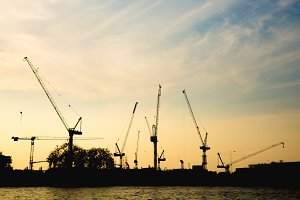 Construction cranes in evening
