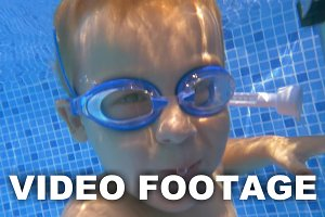 Child wearing goggles diving