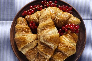 Croissants with Berries on a blue