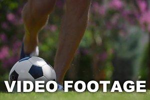 Man kicking a football outdoor