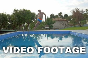 Man jumping into the outdoor pool