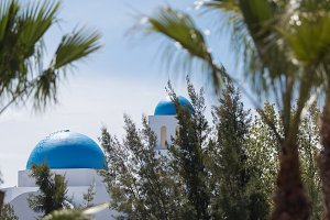 white buildings with blue domes