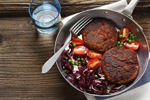 two Vegan Burgers and salad