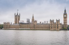 River Thames and Palace of Westminster (known as Houses of Parliament). Palace of Westminster located on bank of River Thames in City of Westminster, London. UK.