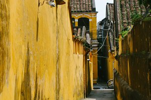 small alley in hoi an, vietnam