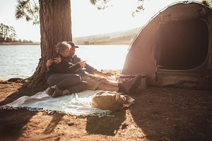Loving senior couple camping