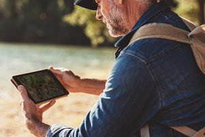 Senior man using digital tab