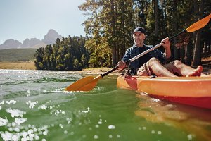 Mature man with enjoying kayaking