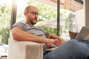 Relaxed mature man using laptop