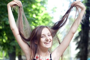 Girl playing with her hair