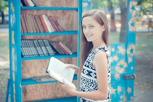 girl near the bookcase in the park