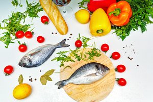 Still life. Vegetables, bread, fish