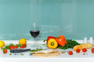Vegetables, bread, wine and fish