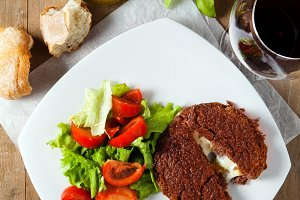 Burger cutlet stuffed with cheese