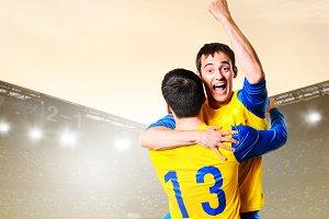 players celebrating goal