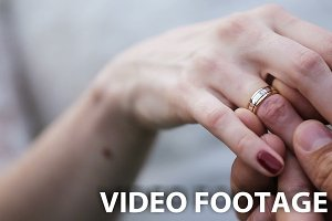 groom putting wedding ring