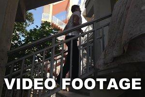 Man running upstairs to the hotel