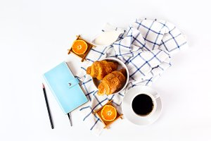 Breakfast with coffee and oranges