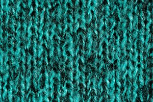 Blue-green wool knitted ornament