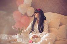 Girl festive breakfast in bed.