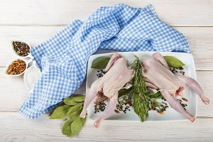 Raw poussin with herbs and spices