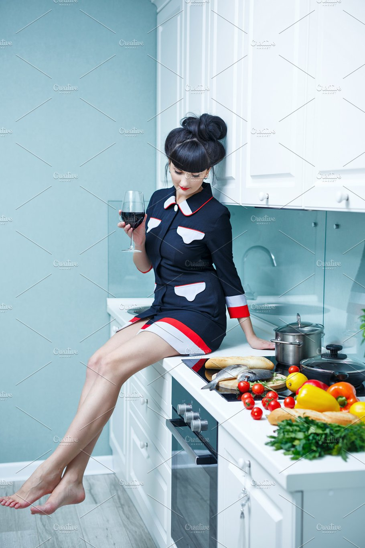 Girl is drinking wine in kitchen. - People Photos | Creative Market Pro
