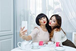 Girlfriends drink tea. Selfie