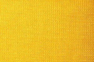 Yellow knitted wool background