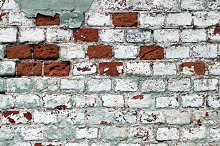 An old brick wall white painted