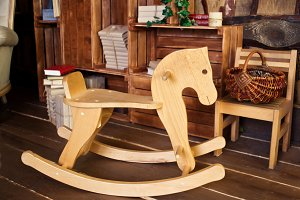 Wooden Rocking Horse on wooden background