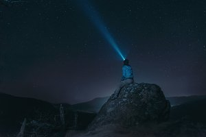 Traveler looking at starry sky