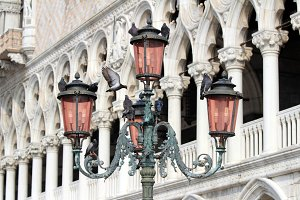 Bella Italia series. Venice - the Pearl of Italy. Ornate lamposts in Piazza San Marco against Doge's Palace. Venice, Italy.