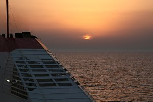 Ship at sunset. The ferry route Italy - Greece, near Bari. Italy. Mediterranean.