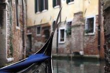 Venice - the Peairl of Italy. Gondola in Venetian canal. Venice, Italy. Shallow DOF.