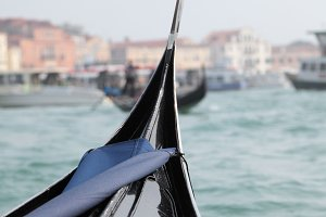Venice - the Peairl of Italy. Gondola in Venice canal near Piazza San Marco. Shallow DOF.
