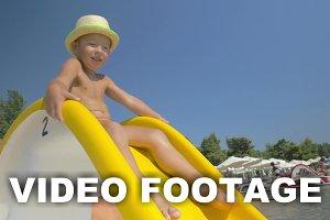 Child riding on slider at seaside