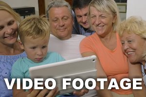 Big family watching video