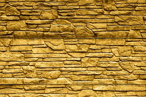 Gold stone brick wall texture