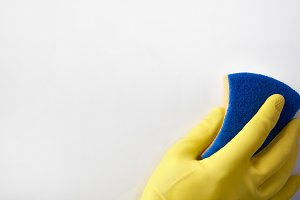 Hand with yellow glove cleaning
