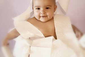 Baby and toilet paper