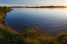 Sunset lake summer panorama.